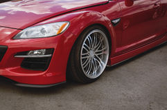 Czereśniowej czerwieni samochodu przodu szczegół fotografia stock