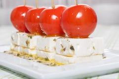 Czereśniowi pomidory z feta oliwa z oliwek i serem Obraz Royalty Free
