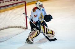 Czerep hokejowa kara strzelał spełnionego młodym gracz w hokeja Obrazy Royalty Free