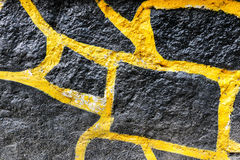 Czerni i koloru żółtego skały ściany tekstura Obraz Royalty Free