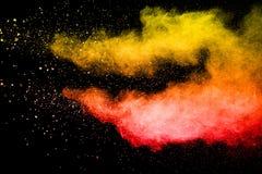 Czerwona żółta koloru pyłu cząsteczka splattered na tle obrazy royalty free