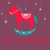 Czerwona drewniana końska wesoło bożych narodzeń powitań karta Fotografia Royalty Free