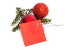 Czerwona etykietka z boże narodzenie dekoracjami Fotografia Stock