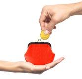 Czerwona kiesa w kobiety ręce i mężczyzna ręce z monetą odizolowywającą na bielu Zdjęcie Stock