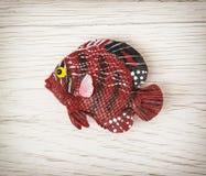 Czerwona klingeryt ryba zabawka fotografia royalty free