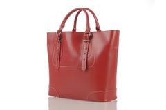 Czerwona kobiety torebka odizolowywająca na białym tle Zdjęcia Stock
