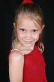 czerwona koszula dziewczyny się uśmiecha Obrazy Royalty Free