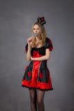 Czerwona królowa cosplay - ładna młoda kobieta Obrazy Stock