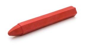 Czerwona kredka na bielu zdjęcia stock