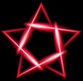 Czerwona neonowa pięcioramienna gwiazda, czarny tło Zdjęcia Royalty Free