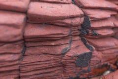 Czerwona osadowa skała. Wieszający Shek Mun, Hong Kong Fotografia Royalty Free