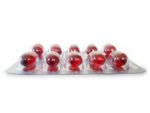 Czerwona pigułka w paczce Zdjęcie Stock