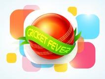 Czerwona piłka z zielonym faborkiem dla krykiet febry Fotografia Stock