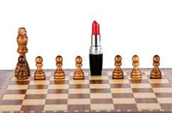 Czerwona pomadka na chessboard Obrazy Royalty Free