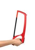 Czerwona ręka zobaczył dla drewna i metalu rozcięcia odizolowywającego Fotografia Stock