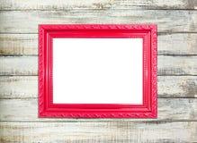 Czerwona rocznika obrazka rama na starym drewnianym tle zdjęcie stock