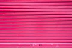 Czerwona rolkowa metalu drzwi powierzchnia Obraz Royalty Free