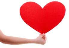 Czerwona serce karta. Miłość symbol. Kobieta chwyta walentynki symbol. Obraz Royalty Free