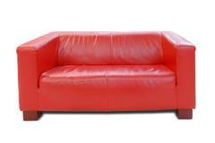 czerwona skórzana sofa Fotografia Stock
