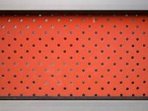 Czerwona stali ściana z mnóstwo dziurą Zdjęcia Royalty Free
