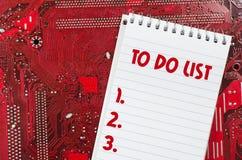 Czerwona stara brudna komputerowego obwodu deska i robić lista teksta pojęciu Fotografia Stock