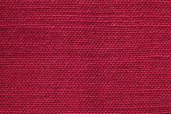 Czerwona tkanina sukienny tekstury tło Szczegół tekstylny materiał w górę fotografia stock