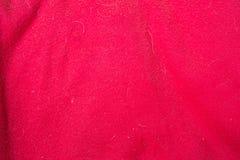 Czerwona tkaniny tekstura z doghair i punktami fotografia stock