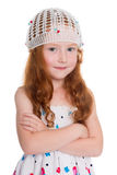 Czerwona z włosami dziewczyna w trykotowej nakrętce Zdjęcia Royalty Free
