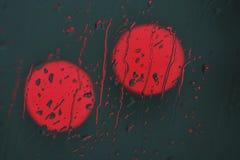 czerwone światło deszczu Obrazy Royalty Free