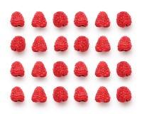 Czerwone świeże malinki na białym tle, pracowniany wizerunek fotografia royalty free