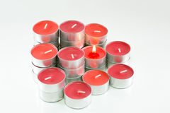 Czerwone świeczki na białym tle Obrazy Stock