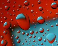 czerwone błękitny krople Obrazy Royalty Free