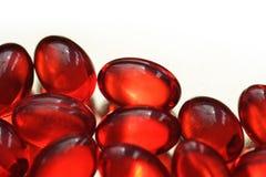 czerwone capslules Zdjęcia Stock