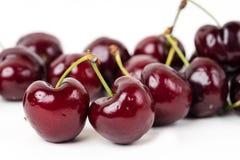 Czerwone czereśniowe owoc z białym tłem Obrazy Stock