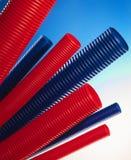 Czerwone i błękitne plastikowe tubki Zdjęcie Royalty Free