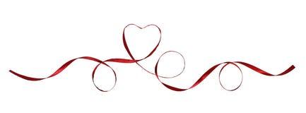 Czerwone jedwabnicze faborek pętle, serce i Fotografia Royalty Free