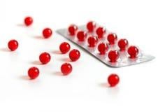 czerwone kapsułki fotografia royalty free