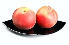 czerwone naczynie czarny brzoskwinie Zdjęcie Stock