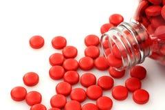 czerwone nadchodzące butelek pigułki Fotografia Stock