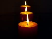 czerwone płonące świeczki Zdjęcie Stock