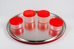czerwone plastikowe zbiornika, Obrazy Stock