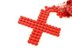 czerwone przecinające target2370_0_ pigułki Fotografia Stock
