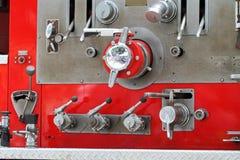 Czerwone samochód strażacki dźwignie zdjęcie stock