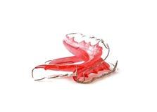Czerwone stomatologiczne stałe wynagrodzenie ortodoncje, odizolowywać na białym tle Zdjęcia Royalty Free