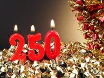 Czerwone świeczki pokazuje Nr 250 Fotografia Royalty Free