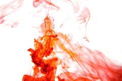 Czerwonego barwionego abstrakt kropli chmury wodnej farby akrylowego poniższego tła błękitnej zieleni żółci pomarańczowi kosmosy  Obrazy Royalty Free