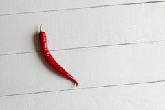 Czerwonego chili pieprz odizolowywający na białej deski tle Zdjęcie Royalty Free