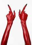 Czerwonego diabła ręki z czerń gwoździami, czerwone ręki szatan, Halloweenowy temat na białym tle, odizolowywającym Zdjęcia Stock