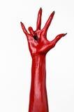 Czerwonego diabła ręki z czerń gwoździami, czerwone ręki szatan, Halloweenowy temat na białym tle, odizolowywającym Fotografia Royalty Free