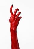 Czerwonego diabła ręki z czerń gwoździami, czerwone ręki szatan, Halloweenowy temat na białym tle, odizolowywającym Fotografia Stock